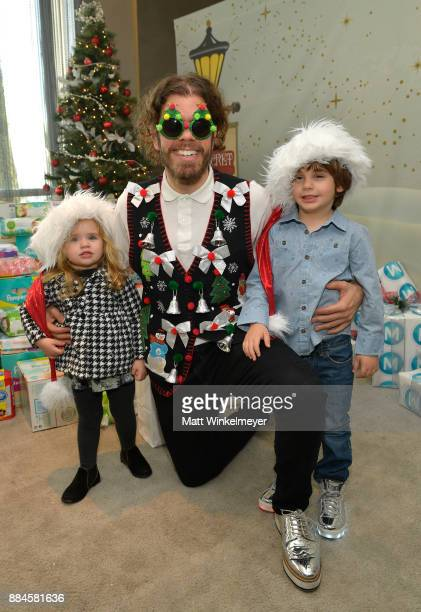 Perez Hilton and children Mia and Mario at the 7th Annual Santa's Secret Workshop benefiting LA Family Housing at Andaz on December 2 2017 in West...
