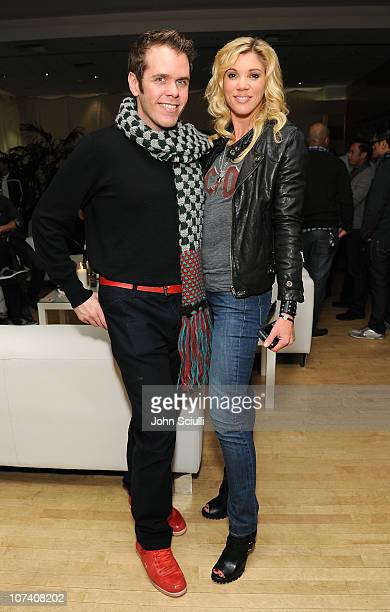 Perez Hilton and Jackie Warner attend the fitperezcom holiday health bash on December 7 2010 in Los Angeles California