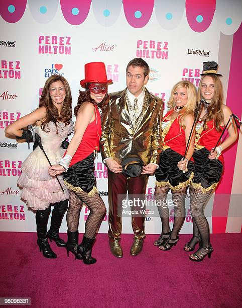 Perez Hilton poses with models at his 'CarnEvil' 32nd birthday party at Paramount Studios on March 27 2010 in Los Angeles California