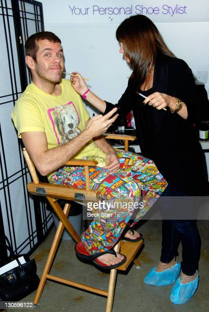 Perez Hilton prepares to debut Sparkle Shine shoes for ShoeDazzle benefiting GLSEN at ShoeDazzle on October 26 2011 in Los Angeles California