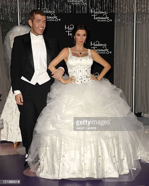 Perez Hilton unveils a Kim Kardashian wax figure in a wedding dress at Madame Tussauds Hollywood on August 18 2011 in Hollywood California