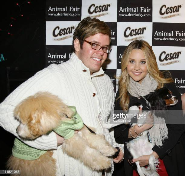 Perez Hilton with his dog Teddy and actress Amanda Bynes and her dog Charlie attend the 'Doggy Fiesta' hosted by Wendy Diamond and her dog Lucky held...