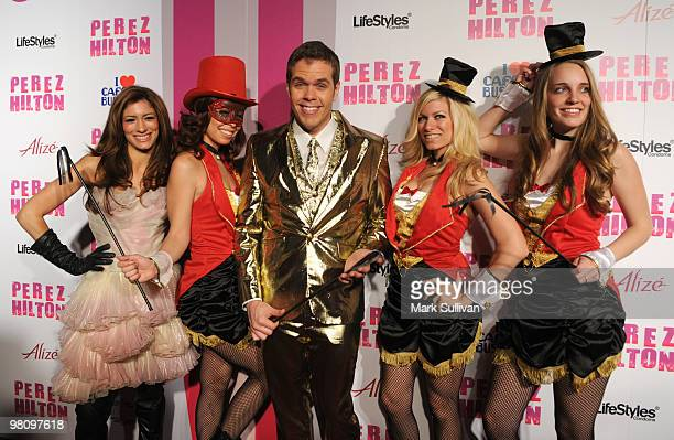 Perez Hilton with models at Perez Hilton's CARNEVIL Theatrical Freak Funk 32nd birthday party on March 27 2010 in Los Angeles California