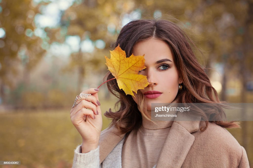 Perfect Autumn Woman Model with Brown Hair, with Fall Fashion Girl Outdoors : Stock Photo