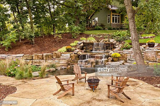 perfect backyard landscaping - fire pit stock pictures, royalty-free photos & images