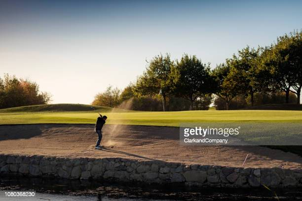 perfect bunker shot. - sand trap stock pictures, royalty-free photos & images