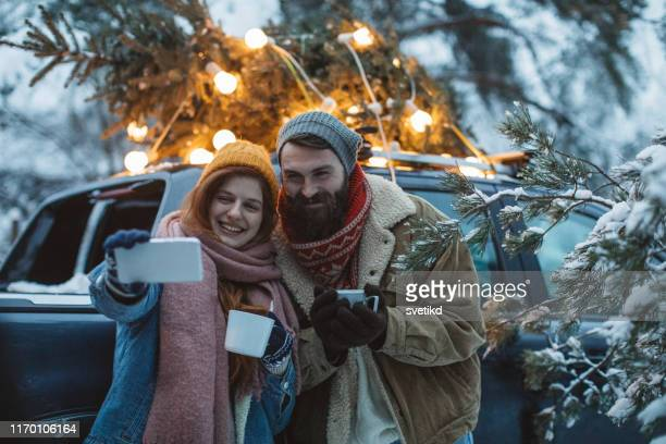 perfect christmas tree is arrived, time for selfie - car decoration stock pictures, royalty-free photos & images
