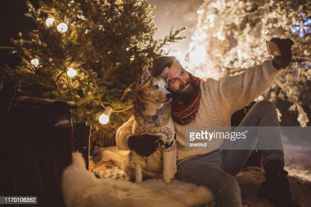 perfect christmas tree is arrived, time for selfie - affectionate stock pictures, royalty-free photos & images