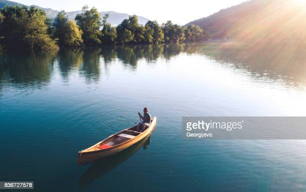 perfect combination of nature and sport - canoe stock pictures, royalty-free photos & images
