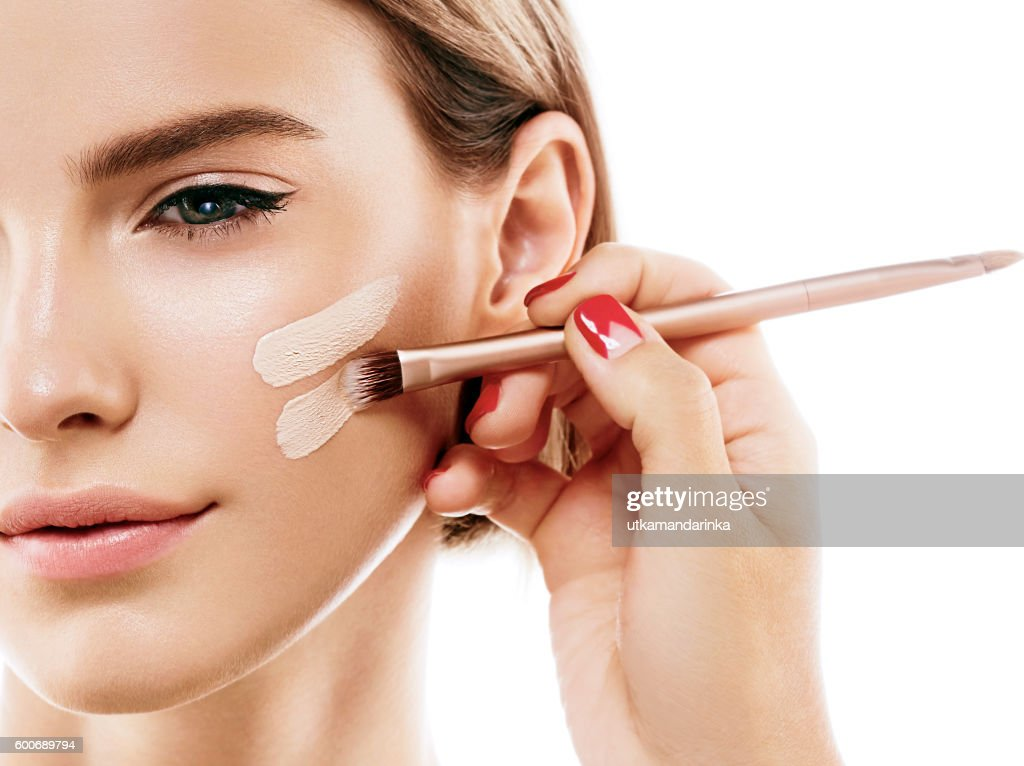 Perfect makeup. Skin tone cream lines on woman face. : Stock Photo