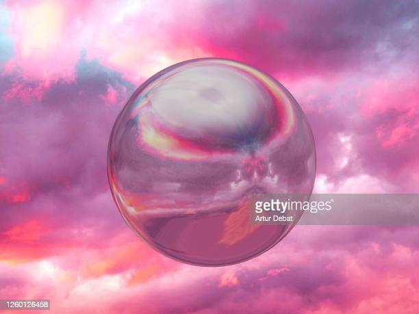 perfect metallic sphere reflecting sunset sky levitating in dramatic sky. - romantic sunset stock pictures, royalty-free photos & images