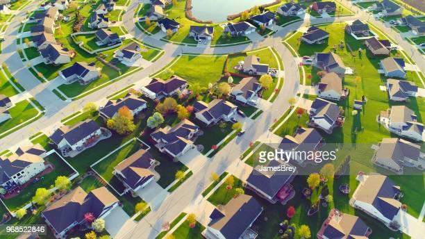 Perfect neighborhoods, homes, Springtime aerial view at sunrise.