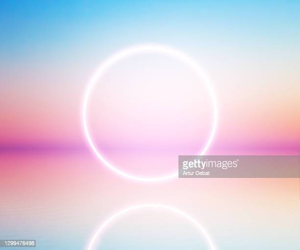 perfect neon ring glowing at sunrise sky levitating over the sea. - image stock pictures, royalty-free photos & images