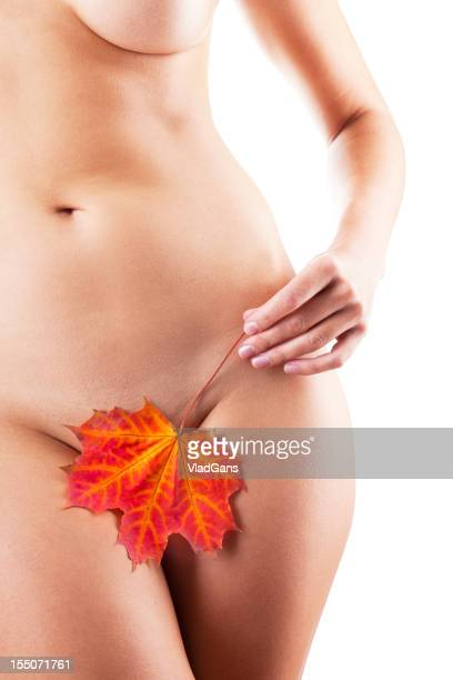 Perfect nude girl torso with maple leaf