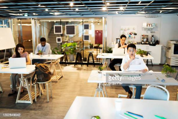 perfect place to find the inspiration you need to succeed - hot desking stock pictures, royalty-free photos & images