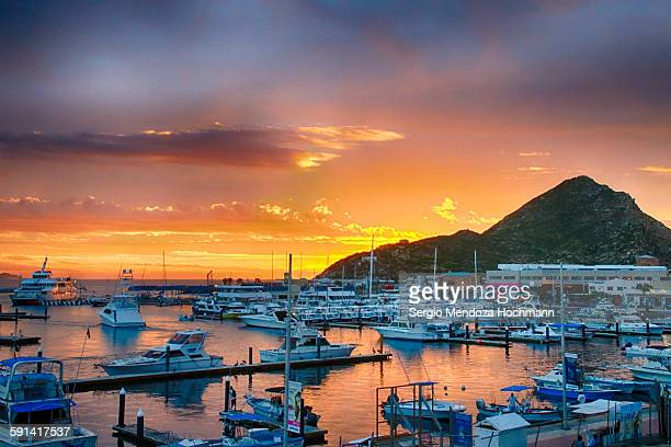 perfect sunrise in cabo san lucas, mexico - cabo san lucas stock pictures, royalty-free photos & images
