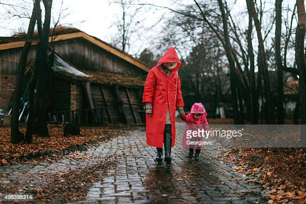 perfect time for a walk - red coat stock pictures, royalty-free photos & images