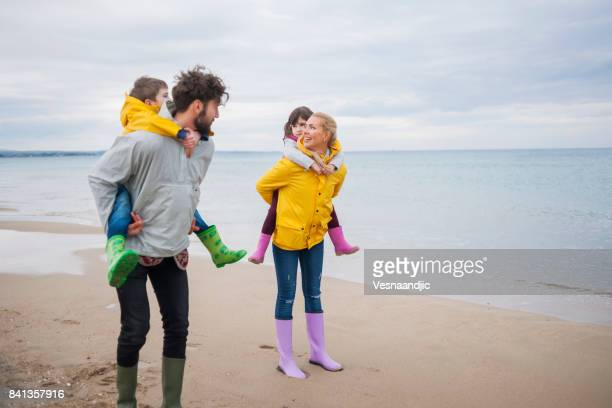 perfect winter vacation - piggyback stock photos and pictures