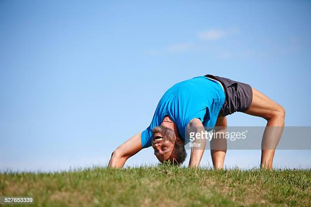 perfecting a difficult posture - bending stock pictures, royalty-free photos & images