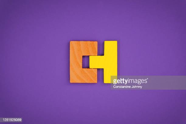 perfectly fit together concept with wood block puzzle - symbol stock pictures, royalty-free photos & images