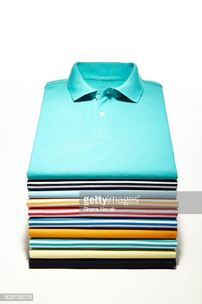 perfectly folded polo stack - top garment stock photos and pictures