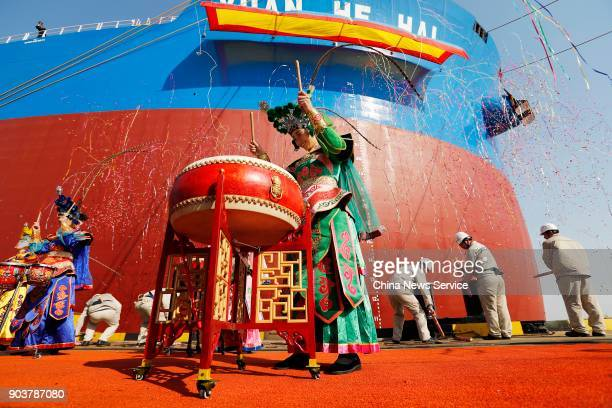Perfoemrs play drums as the Shanghai Waigaoqiao Shipbuilding Co Ltd delivers its secondgeneration very large ore carrier Yuanhehai on January 11 2018...