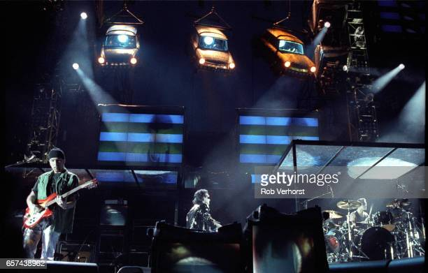 U2 perform on stage at Feyenoord Stadiium on the Zoo TVZooropa Tour De Kuip Rotterdam Netherlands 9th May 1993 LR The Edge Bono Larry Mullen Jr