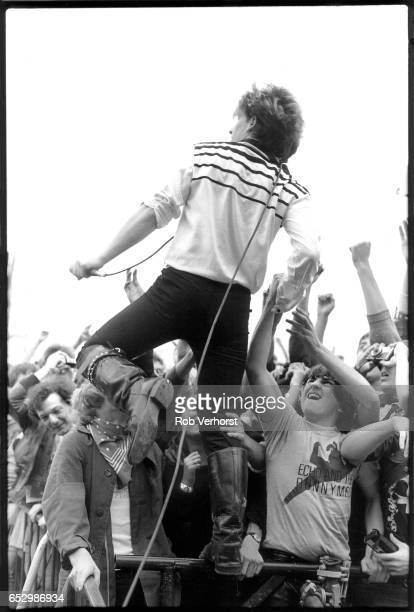 U2 perform on stage during the 'October' tour at Torhout festival Belgium 3rd July 1982 LR The Edge Bono Adam Clayton