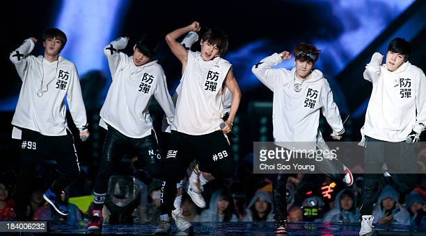 BTS perform onstage during the 2013 Hallyu Dream concert at Gyeongju Civic Stadium on October 6 2013 in Gyeongju South Korea