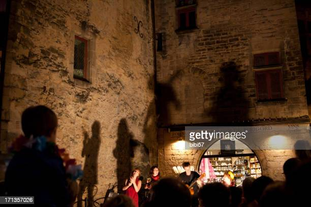 performance and shadow on the wall - sarlat stock photos and pictures