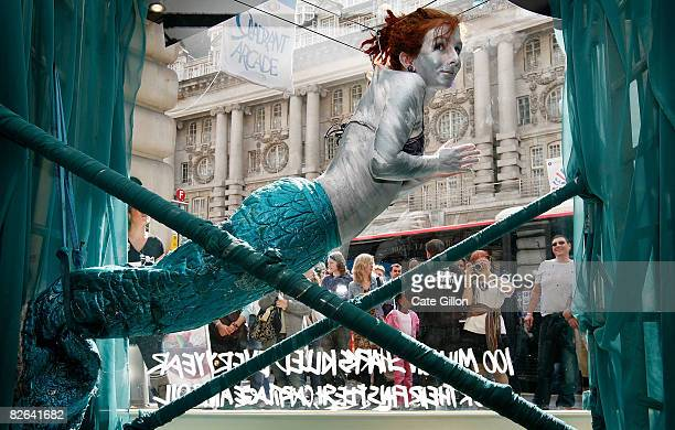 Performance artist Alice Newstead hangs from shark hooks in the window of Lush's Regent Street store on September 3 2008 in London England 100...