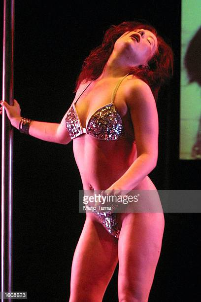 Performance artist and lap dancer Cathy MacGregor rehearses for her one woman multimedia show Scarlett''s Story August 10 2001 at the Castillo...