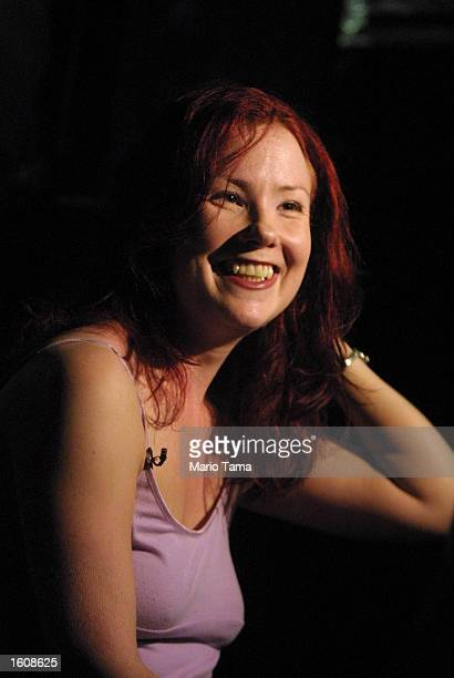 Performance artist and lap dancer Cathy MacGregor smiles after rehearsing for her one woman multimedia show Scarlett''s Story August 10 2001 at the...