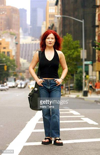 Performance artist and lap dancer Cathy MacGregor stands on a Manhattan street August 11 2001 in New York City MacGregor who holds a PhD in drama and...