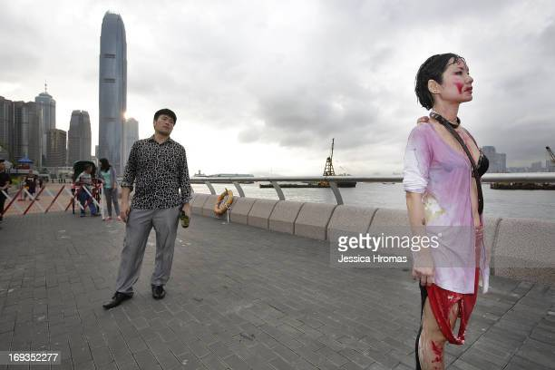 Performance Artist Angela Su participates in the 'Paper Rain' parade along the foreshore of Victoria Harbour to mark the opening of Art Basel on May...