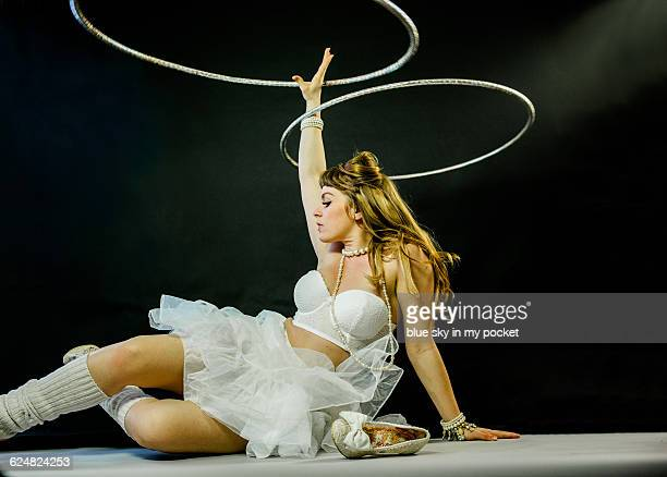 A performance artist dancing with a hoop