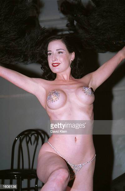 Performance artist Dita Von Teese performs on stage during Joseph's 25th anniversary party on October 20 2002 in West Hollywood California