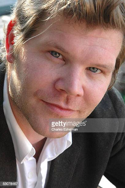 Performance artist Kerry Skarbakka 34yearsold rests on his fire escape after hanging from it by rope and harness at his studio May 14 2005 in the...