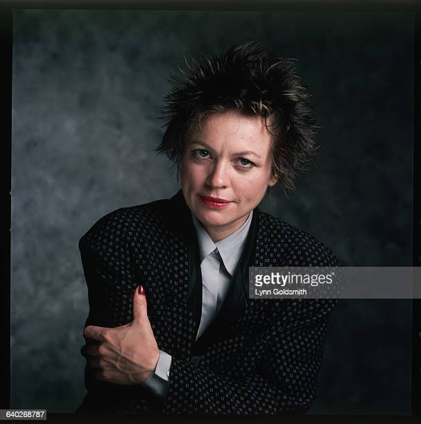 Performance artist Laurie Anderson is seen with her arms folded in this studio portrait Undated