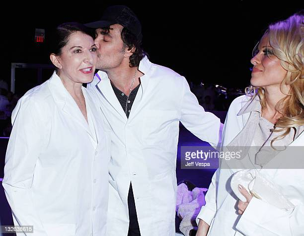 Performance artist Marina Abramovic photographer David LaChapelle and Pamela Anderson attend 2011 MOCA Gala An Artist's Life Manifesto Directed by...