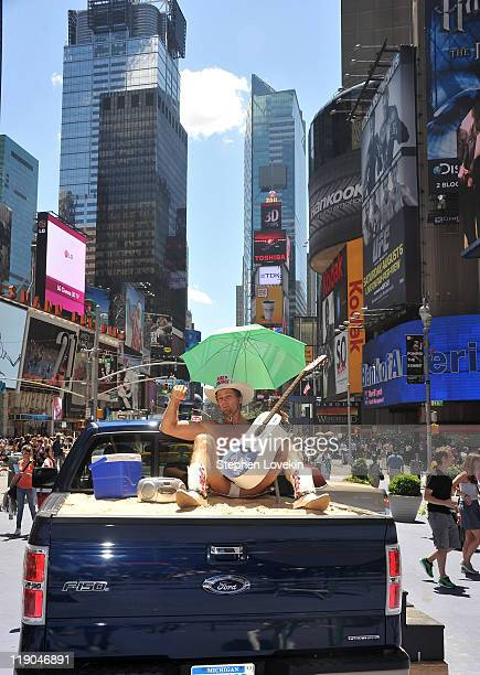 Performance artist Robert John Burck aka The Naked Cowboy sits in the back of a Ford F150 truck as part of a public art exhibit by artist Ryan Roa in...