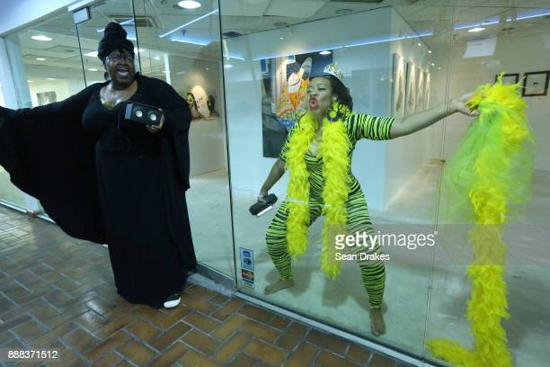 Performance artists Ayana Evans and Dominique Duroseau perform a work titled 'Sparkle' at Prizm Art Fair on East Flagler Street during Art Basel...