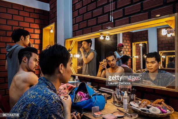 Performance artists prepare hair and makeup backstage before a nightly performance at Phare The Cambodian Circus on May 29 2018 in Siem Reap Cambodia...