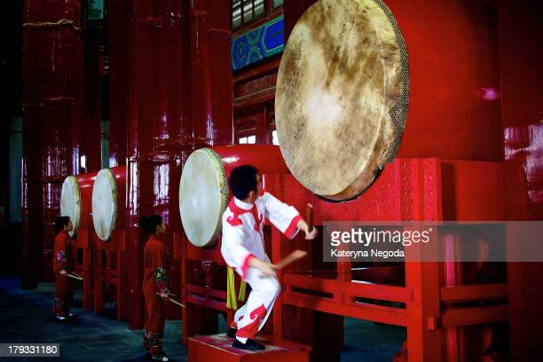 Performance at Beijing Hutong Drum Tower, China. The drum tower of Beijing originally built for musical reasons, it was later used to announce the...
