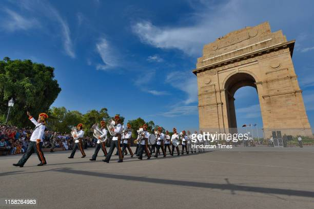 Performance by bands of the Indian Army, Navy and other regiments dedicated to the soldiers who were killed during the Kargil War, at India Gate war...