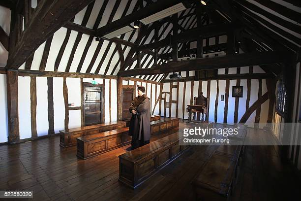 Performance guide Sam Lesser poses in the former schoolroom of William Shakespeare at King Edward VI School on April 20 2016 in StratforduponAvon...