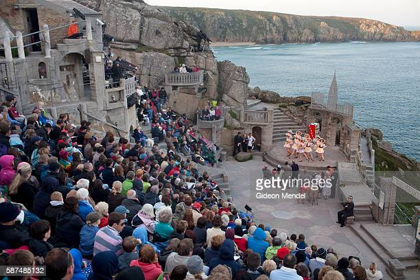 A performance of Guys and Dolls takes place at the famous Minack Theatre in Cornwall This remarkable openair amphitheatre is carved into the rock...