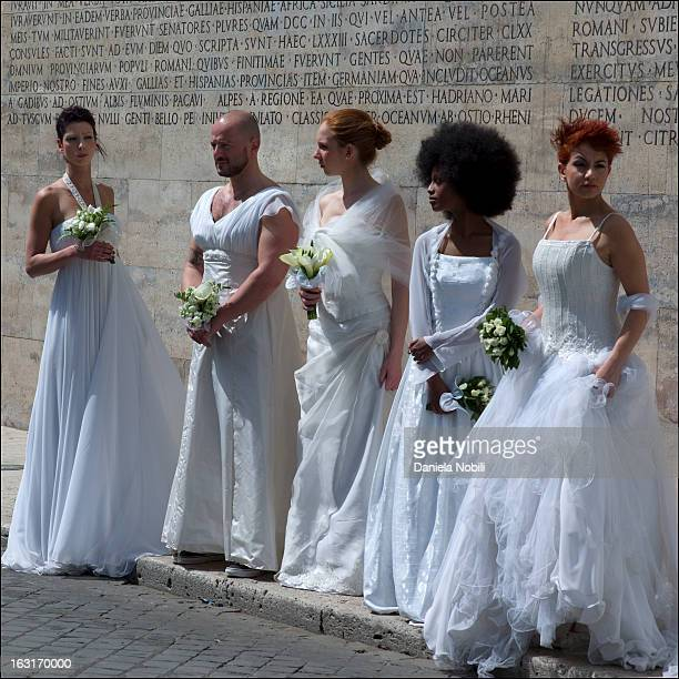 Performance of the young artist Nicola Mette in the streets in Rome, on April 2012. A group of brides - both female and male - walked in several...