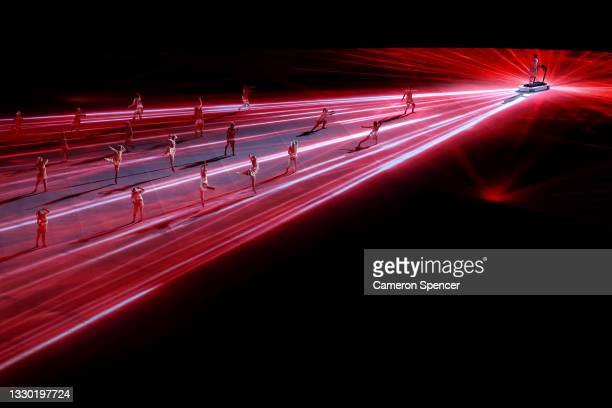 Performances dance during a light show during the Opening Ceremony of the Tokyo 2020 Olympic Games at Olympic Stadium on July 23, 2021 in Tokyo,...