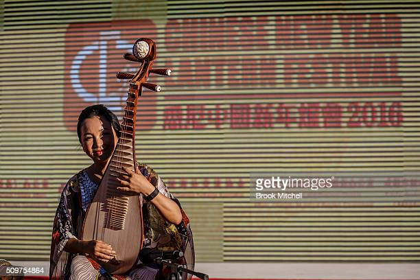 A performer at the Chinese New Year Lantern Festival at Tumbalong Park on February 12 2016 in Sydney Australia The lighting of lanterns is a...